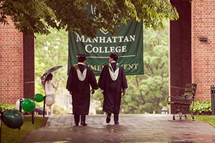 Photo of two graduates walking